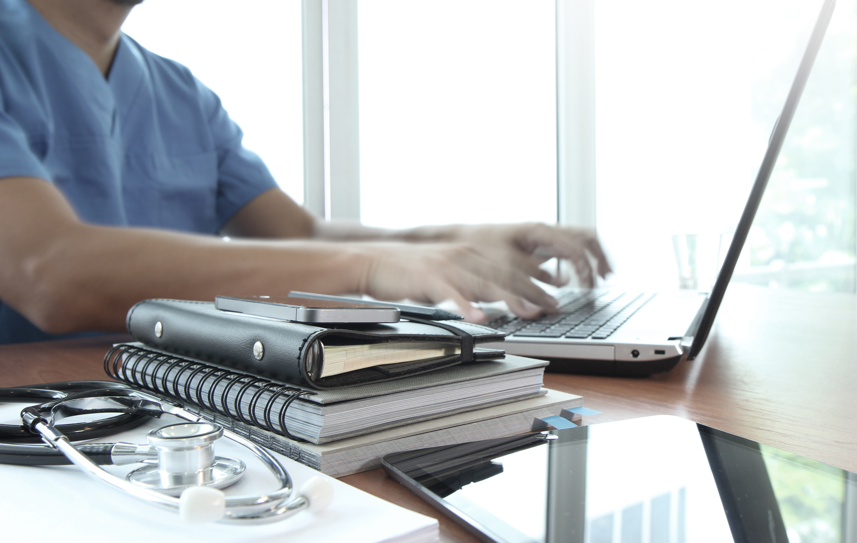 Doctor working with laptop computer in medical workspace office